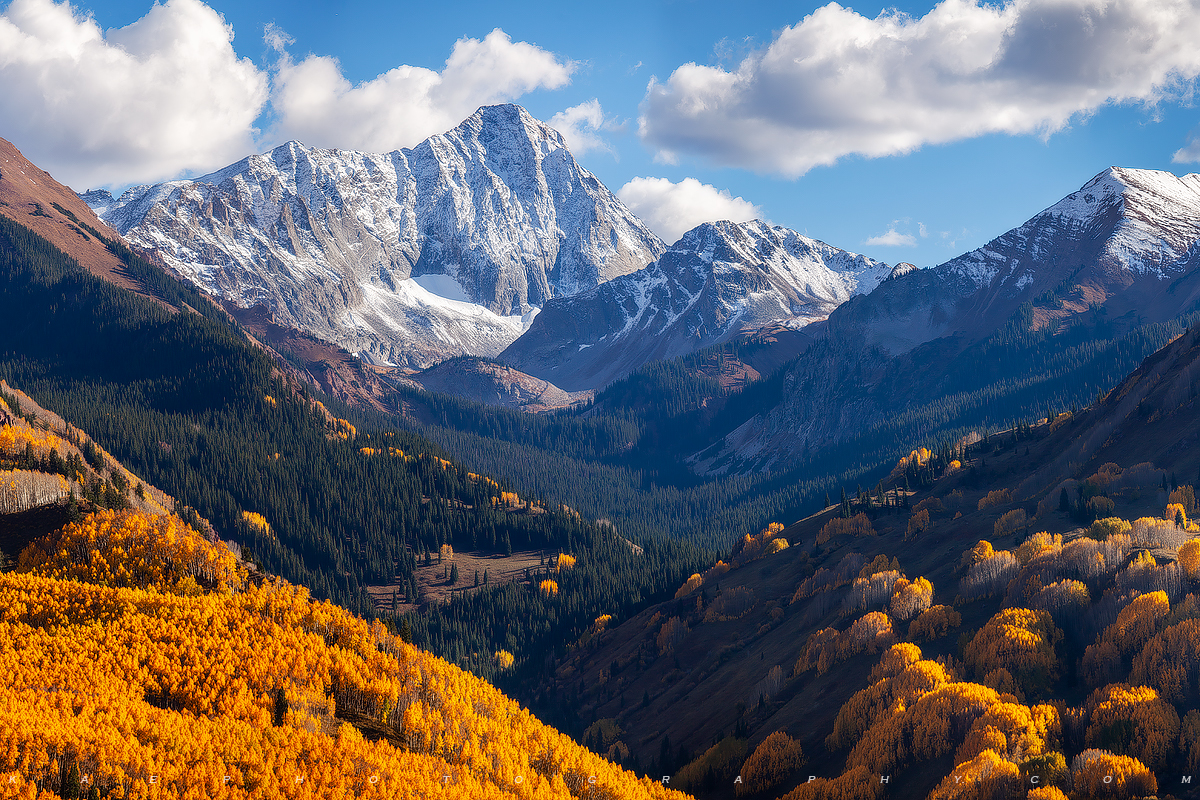 The beautiful 14er Capitol Peak towers above Capitol Creek Valley with fall colors.