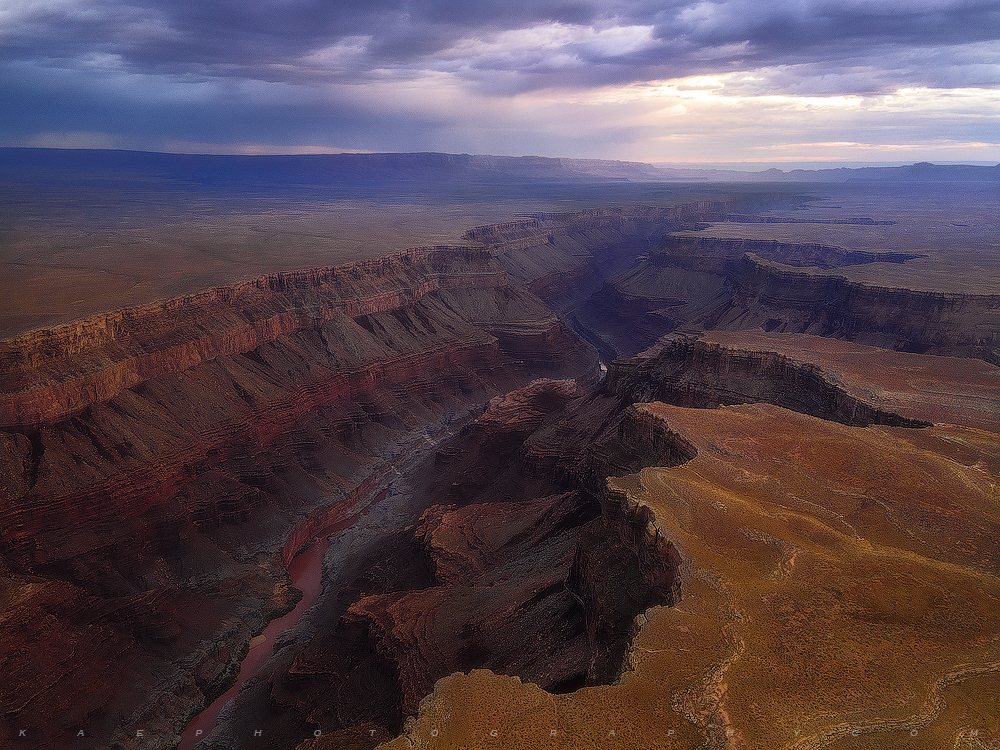 The mighty Colorado River is revealed, deep below the desert rim; and beginning to carve a a beautiful journey into the Grand...