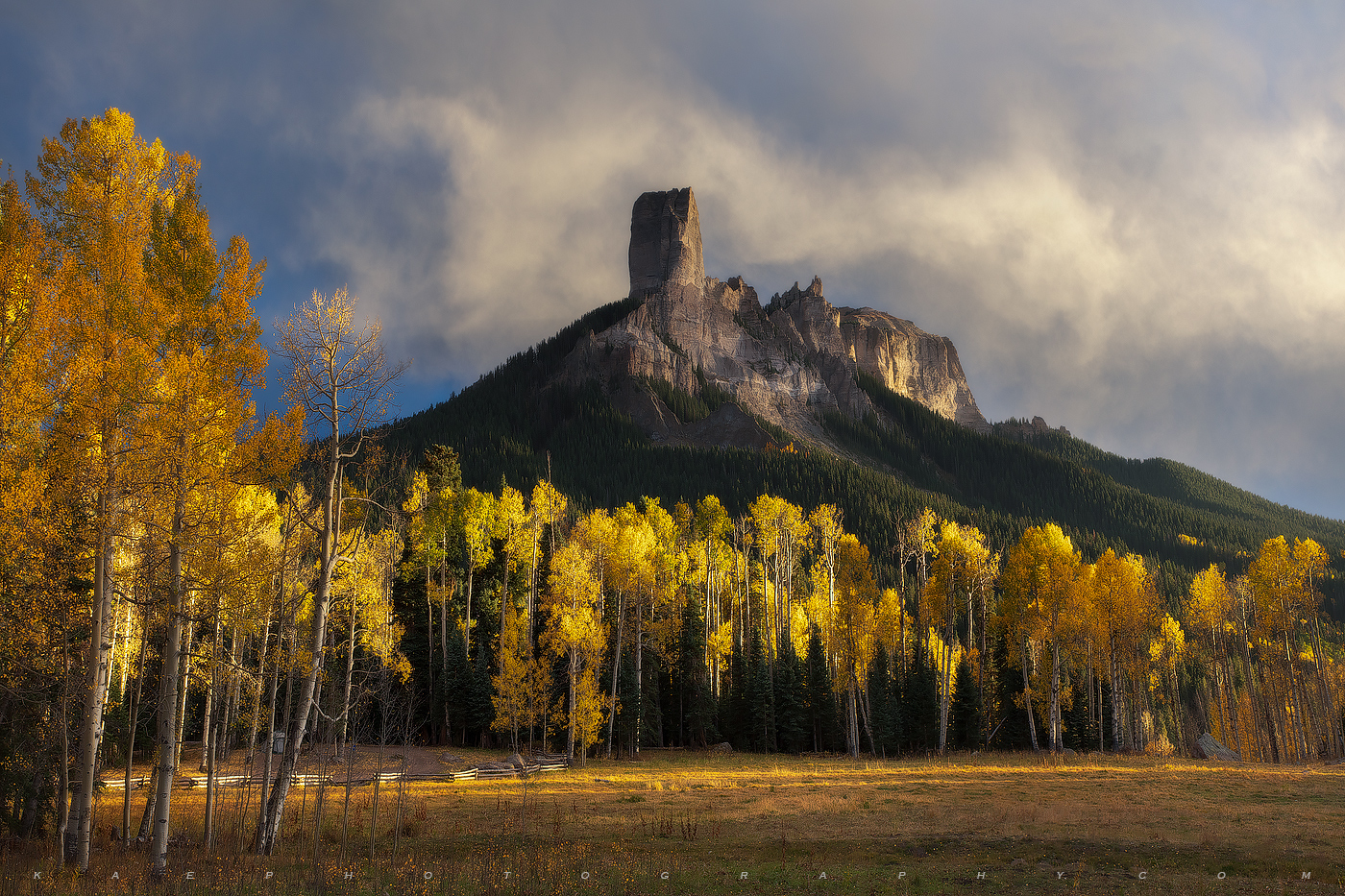 Chimney Rock towers over the beautiful True Grit movie scene, Colorado.  During fall color, the aspen trees provide for a beautiful...